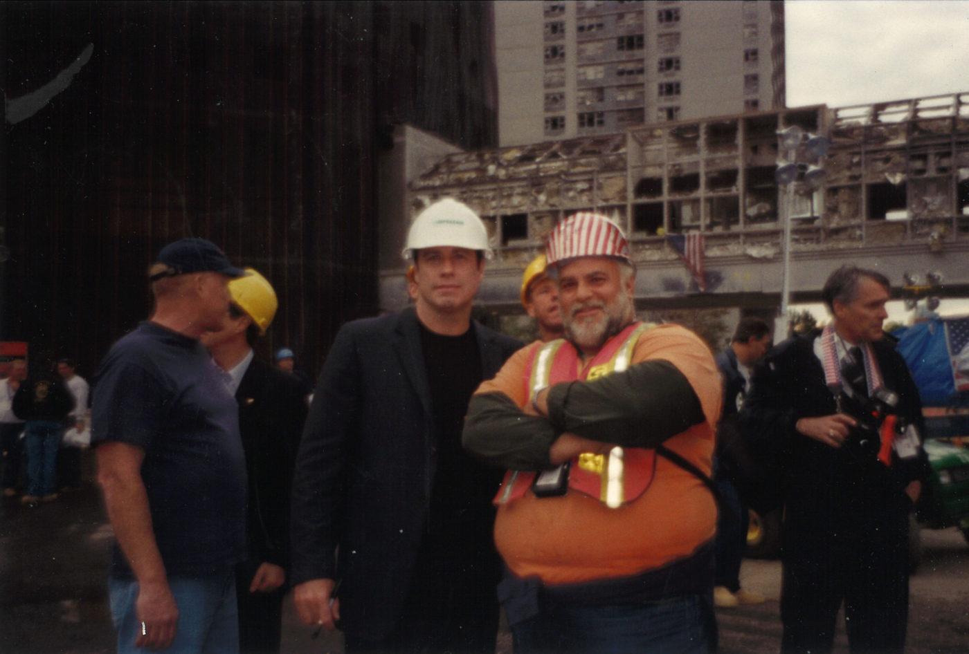 John Travolta and an Unknown Worker at Ground Zero