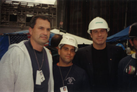 John Travolta Takes a Photo with two Unknown Workers at Ground Zero