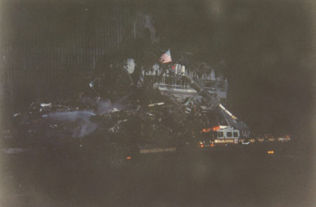 Ladder 87 (Staten Island) with American Flag at Ground Zero