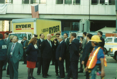 Mayor Guliani (center, sunglasses) with Henry Kissinger (in front of him to right) Points Towards Ground Zero, Oct. 2,2002