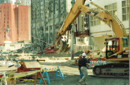 Men and Crane Working with Destroyed Deutsche Bank Building in the Back