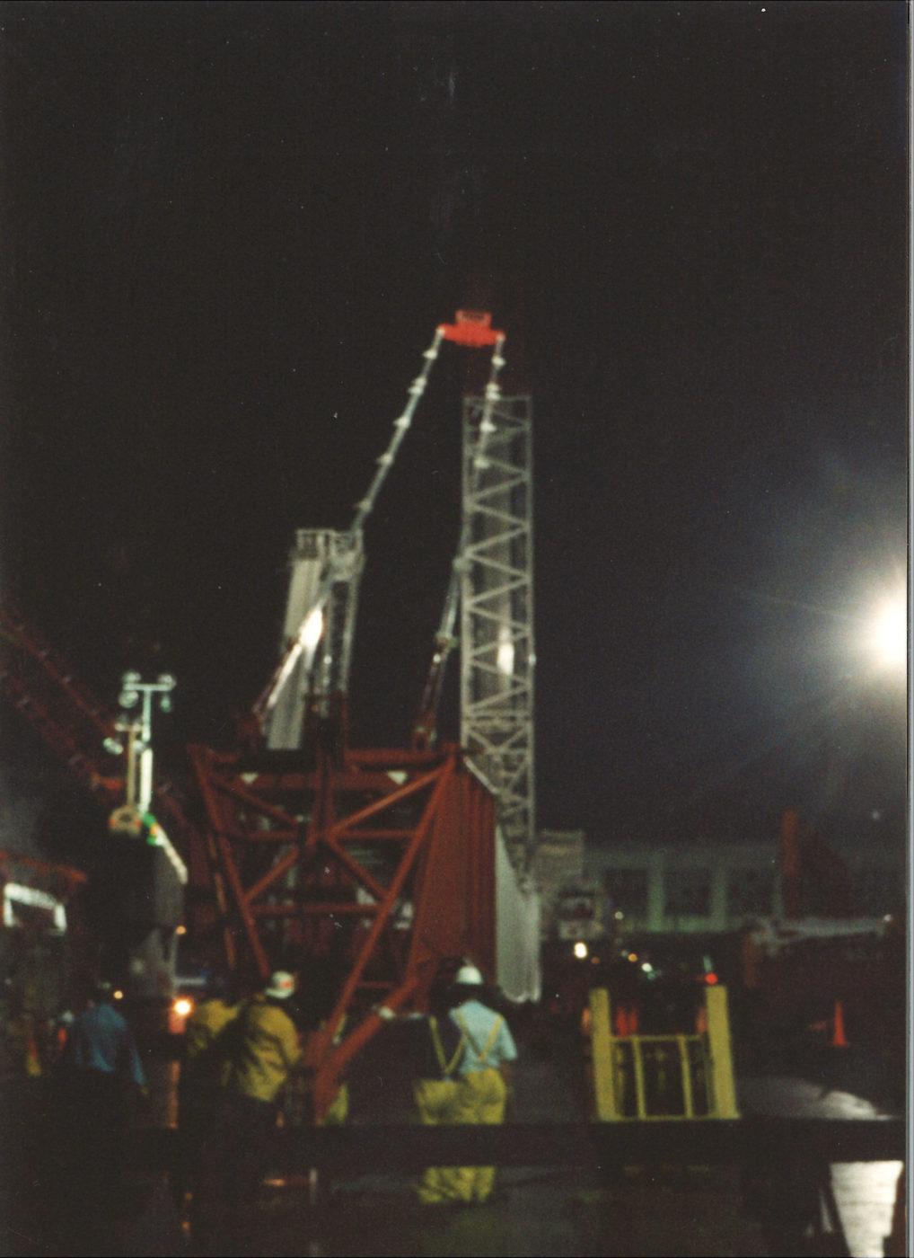 Men working on a crane at night