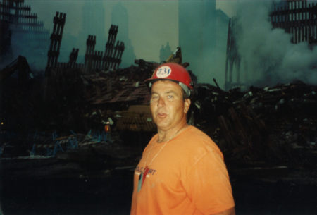 Photo of A Worker from Local 731 at Ground Zero at Night