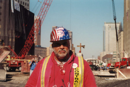 Photo of an Unknown Local 731 Worker in front of the Cross at Ground Zero
