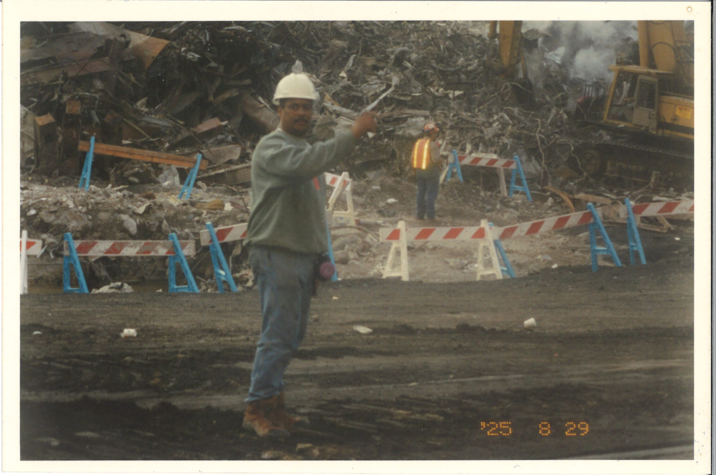 Photo of an Unknown Worker Pointing at Ground Zero