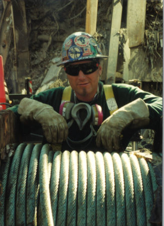 Photo of an Unknown Worker with Steel Cable