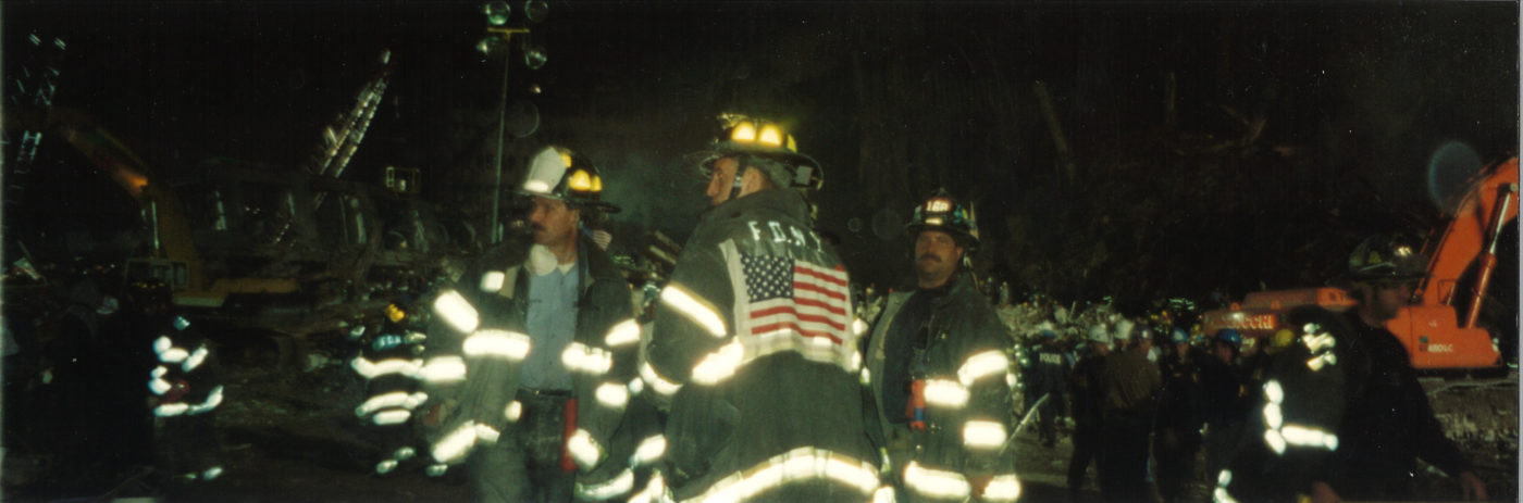 Photo of Three Fire Fighters at Night at Ground Zero