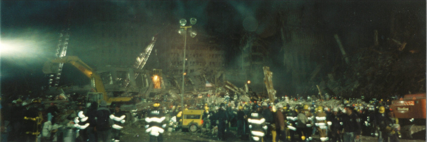 Photo of Workers and Fire fighters at night at Ground Zero