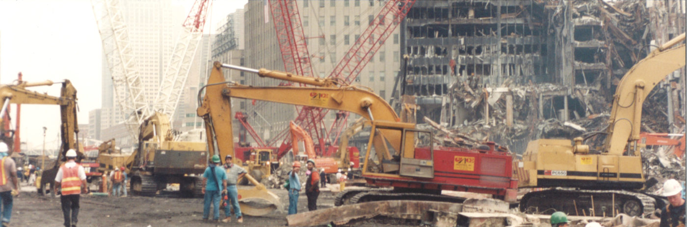 Photo of Workers at Ground Zero with Diggers and Cranes in the Background