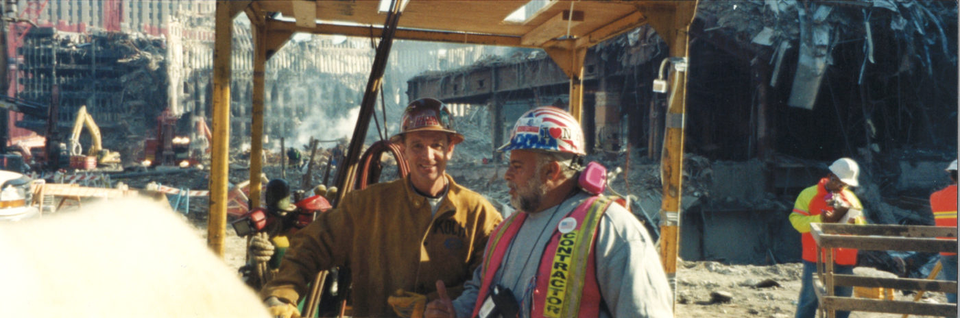 Portrait Shot of Two Workers in Crane Box