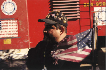 Profile Photo of an Unknown Worker Beside a Fire Truck