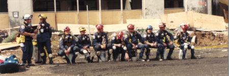 Rescue Workers Taking a Break on Buckets