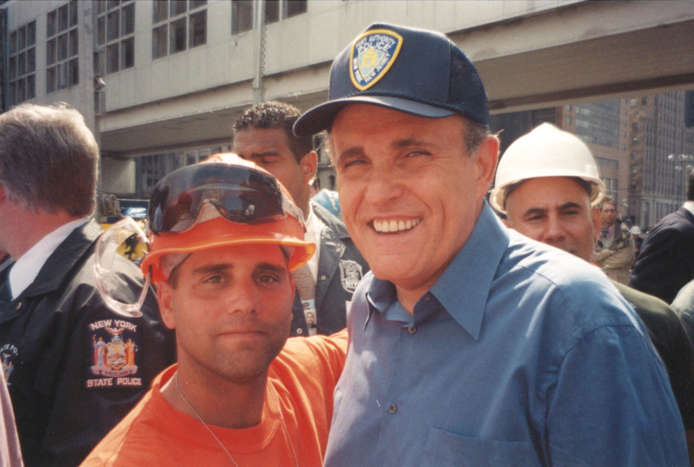 Rudy Guliani and an Unknown Worker Take a Photo at Ground Zero