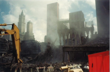 Smoke Rising Over Ground Zero with The Woolworth, The Transportation Building, The Millenium Hote and 22 Cortlandt in the Background