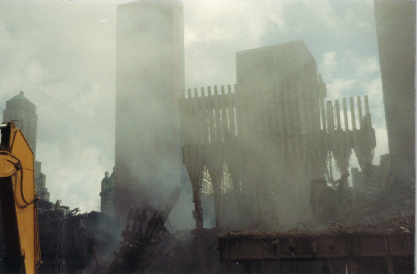 Smoke Rising Over Ground Zero, With the Exoskeleto of the WTC in the Background