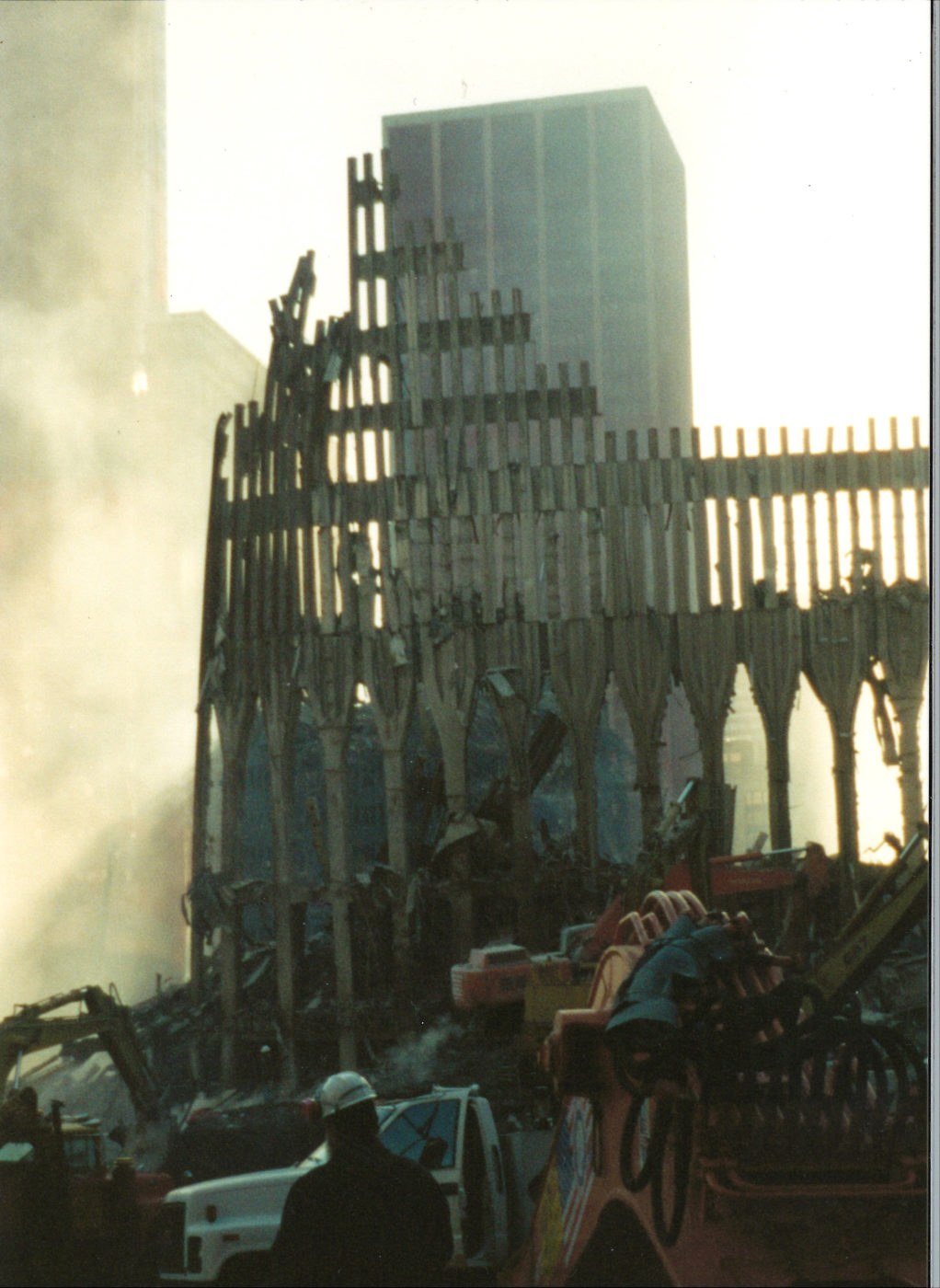 Smoke Rising Through Destroyed Exoskeleton