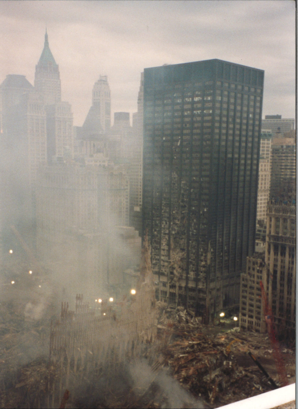 Smoke rising through the WTC Exoskeleton wirh blown out windows on the Deutsche Bank building