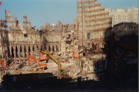 Sun Shining Over Diggers Working on the Debris of the WTC