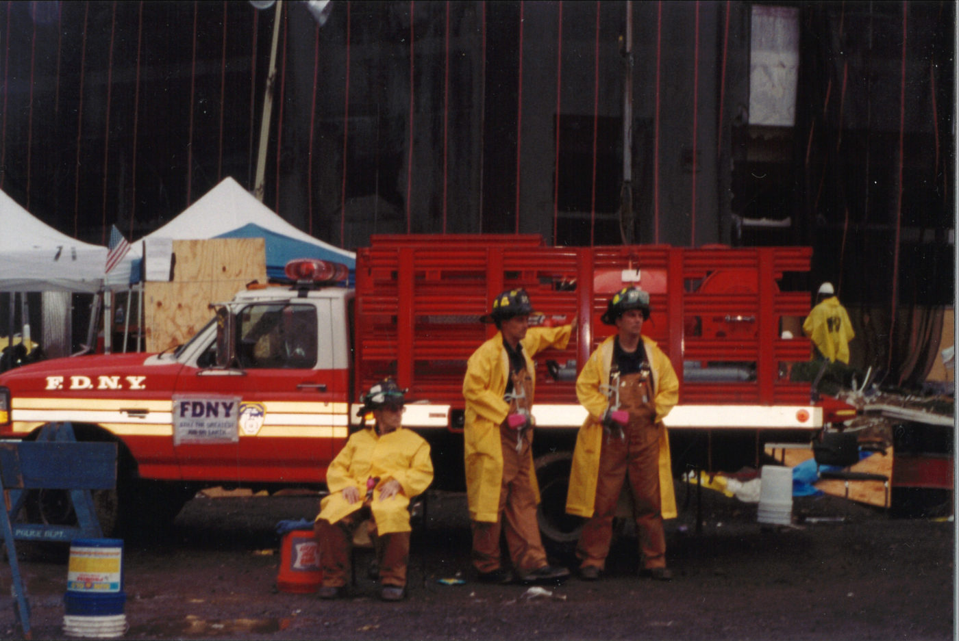 Three Fire Fighters at the FDNY Truck at Ground Zero