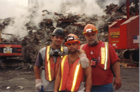 Three Unknown Workers Take a Photo at Ground Zero