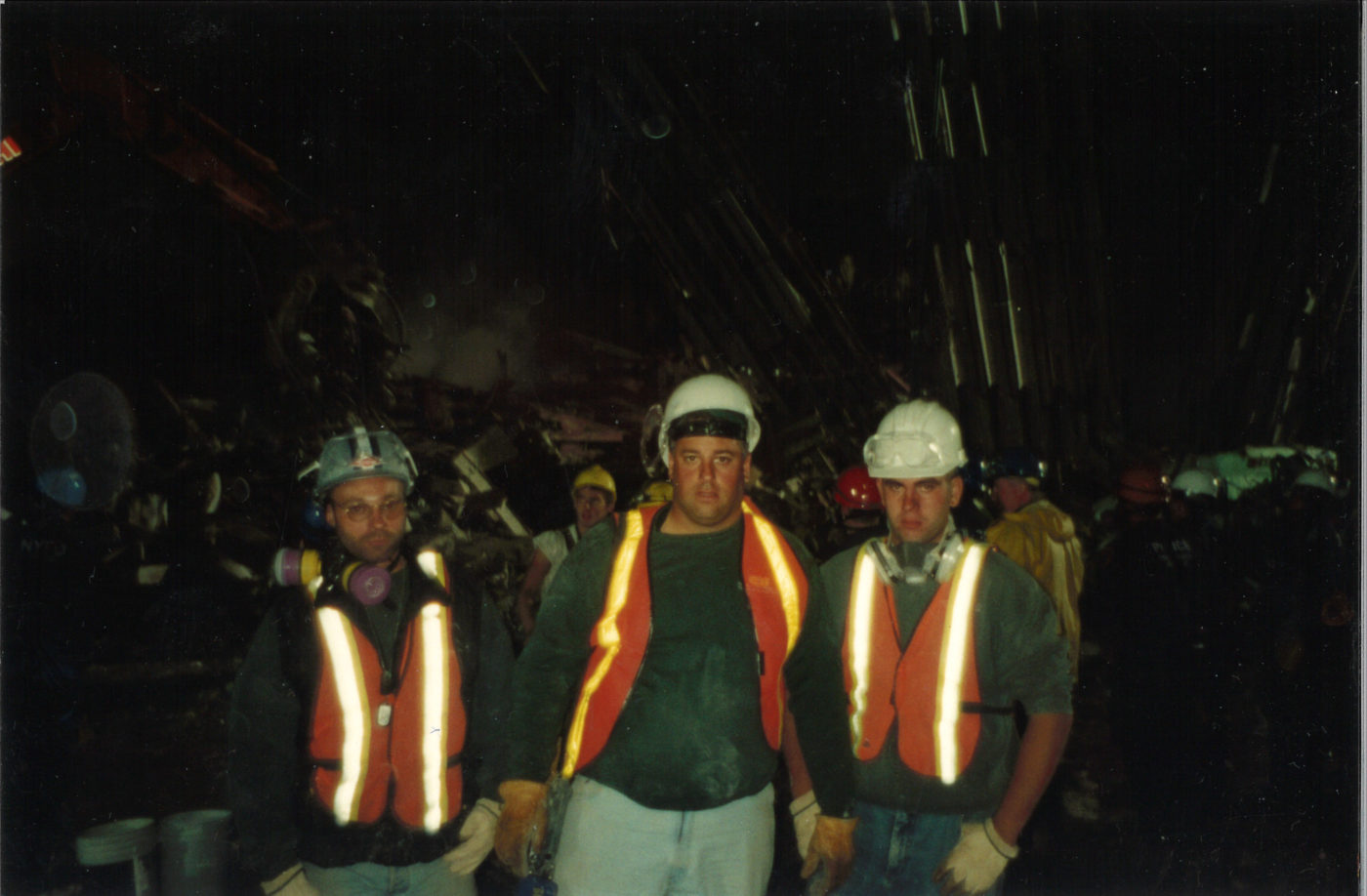 Three Unknown Workers Take a Photo at Night at Ground Zero