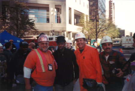Three Unknown Workers Take a Photo with Chris Rock at Ground Zero