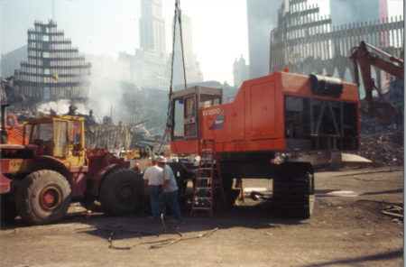Two Men Working with Large Marchinery at Ground Zero
