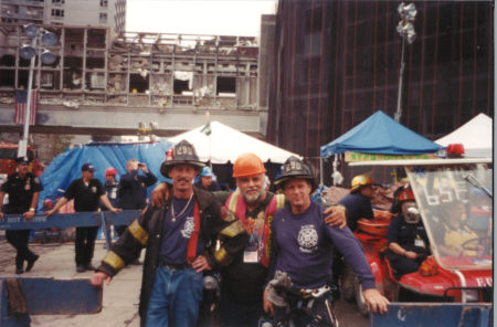 Two Unknown Firefighters and One Unknown Worker Stop for a Photo Together