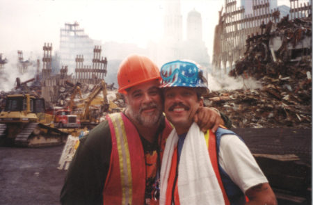 Two Unknown Workers Embrace and Smile Together for a Photo at Ground Zero
