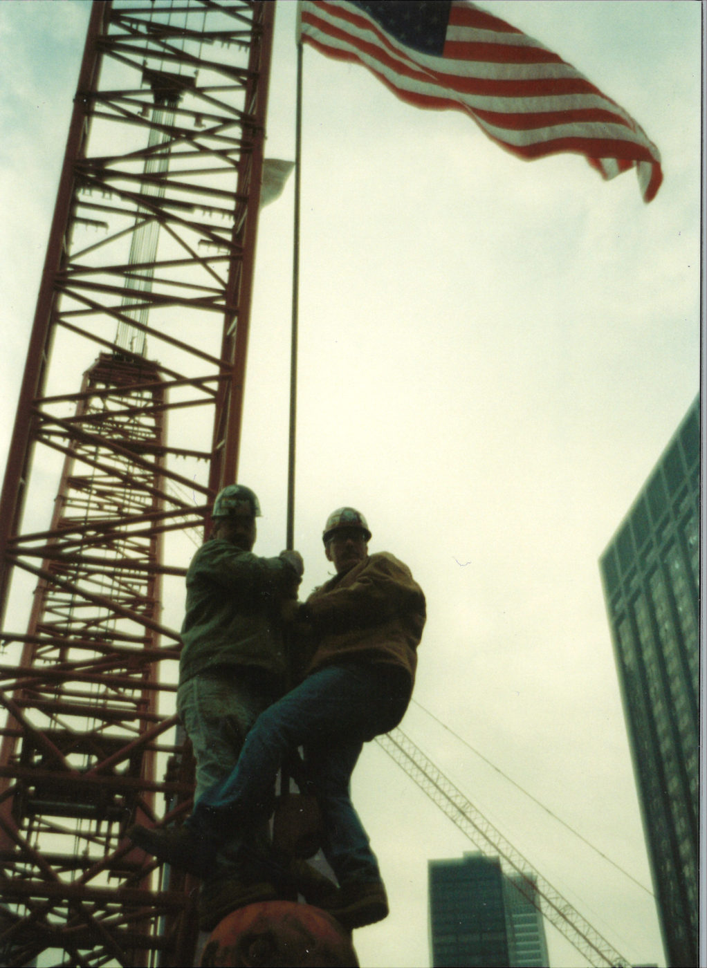 Two Unknown Workers Hanging on a Crane Hoist at Ground Zero
