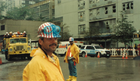 Two Unknown Workers in the Rain with a Truck carrying workers in the back outside Gateway Plaza in Battery Park City