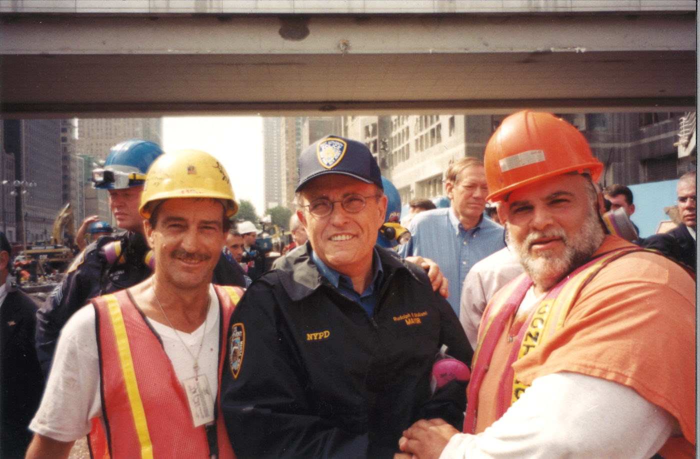Two Unknown Workers with Mayor Guiliani (center) at Ground Zero.