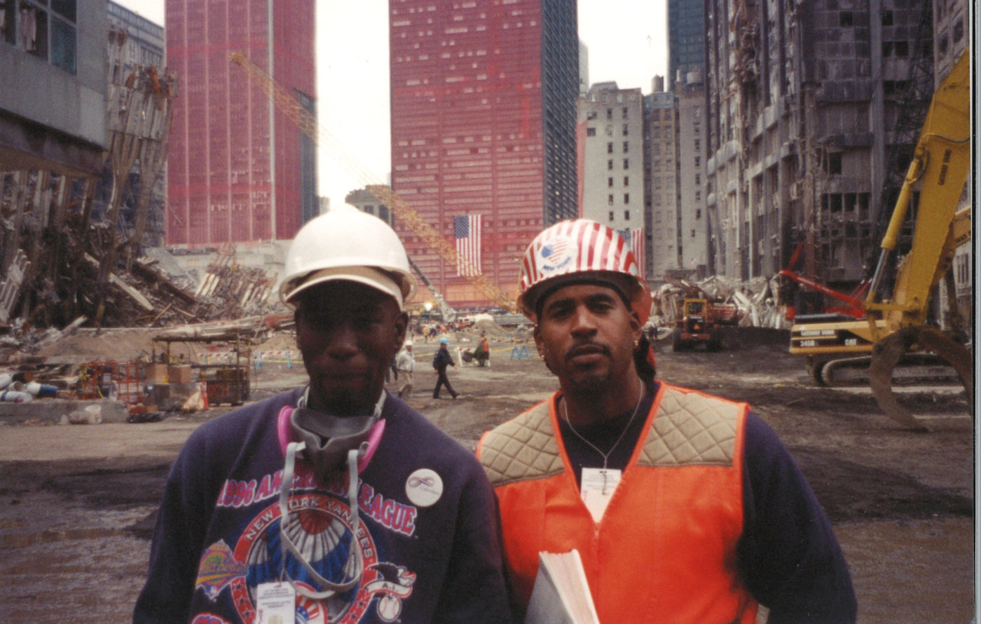 Two Unknown Workers, one with a Love New York Sticker, Stop for a Photo at Ground Zero