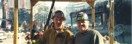 Two Workers in a Crane, One with Koch on his Jacket