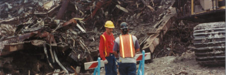 Two Workers Standing Beside Falling and Destroyed Steel