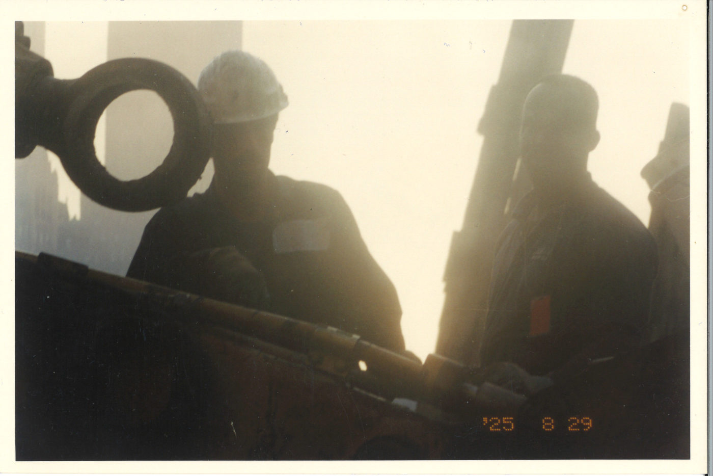 Two Workers with the Sun from Behind at Ground Zero