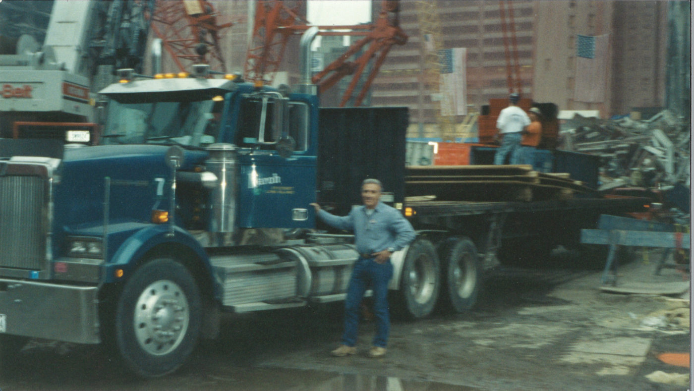 Unknown Driver Standing with a Flatbed Truck at Ground Zero