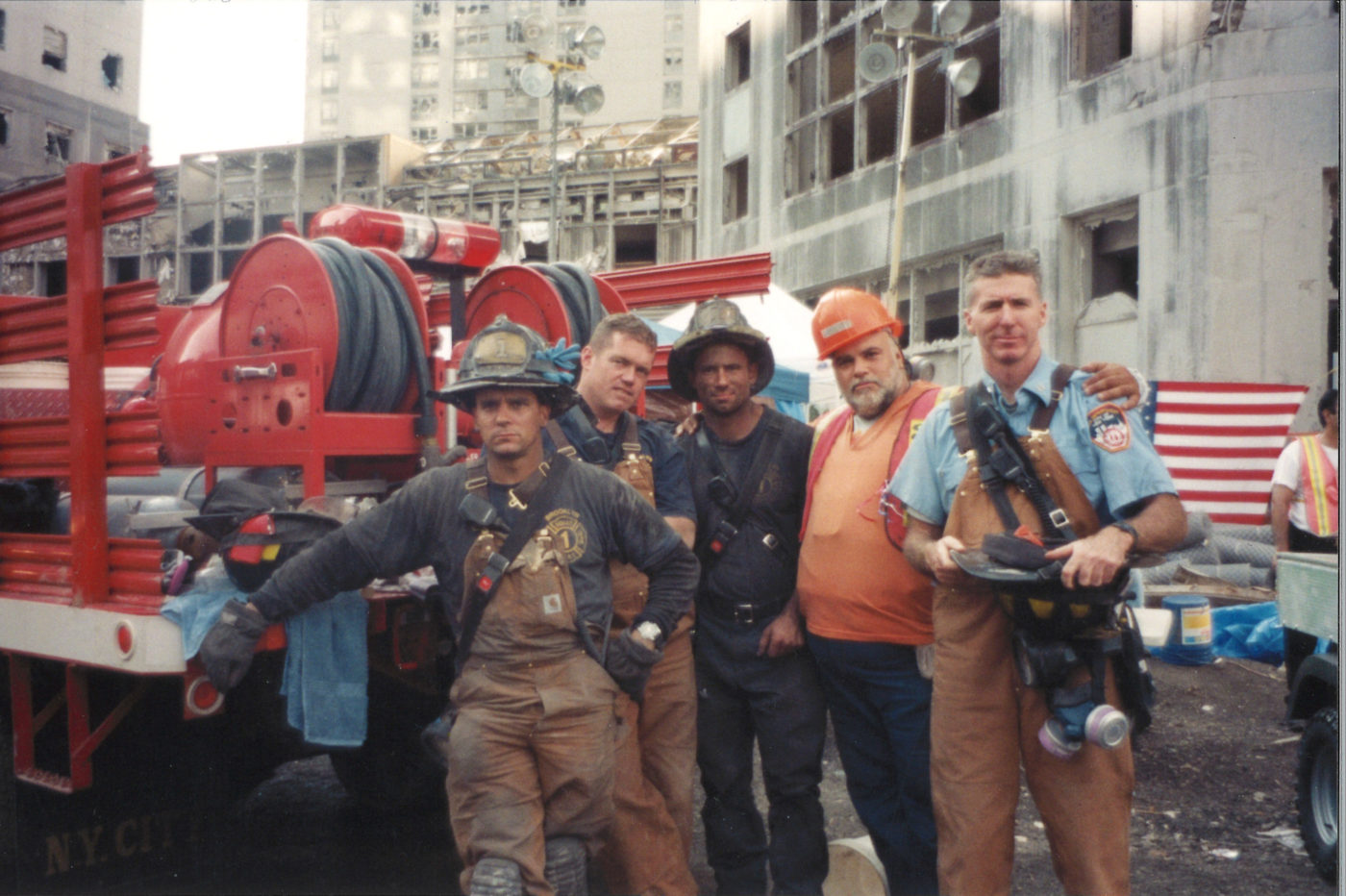 Unknown Fire Fighters and Workers Covered in Dust Stop for a Photo