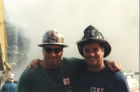 Unknown Iron Worker from Local 40 and Fire Fighter Embrace for a Photo