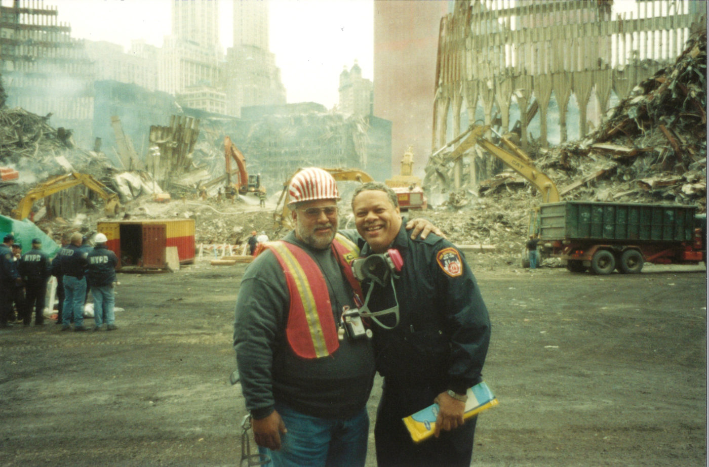 Unknown Local 731 Contractor and an FDNY Firefighter Take Photo Together at Ground Zero