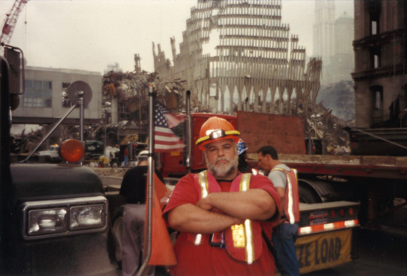 Unknown Worker Crosses His Arms for a Photo in front of Work at Ground Zero