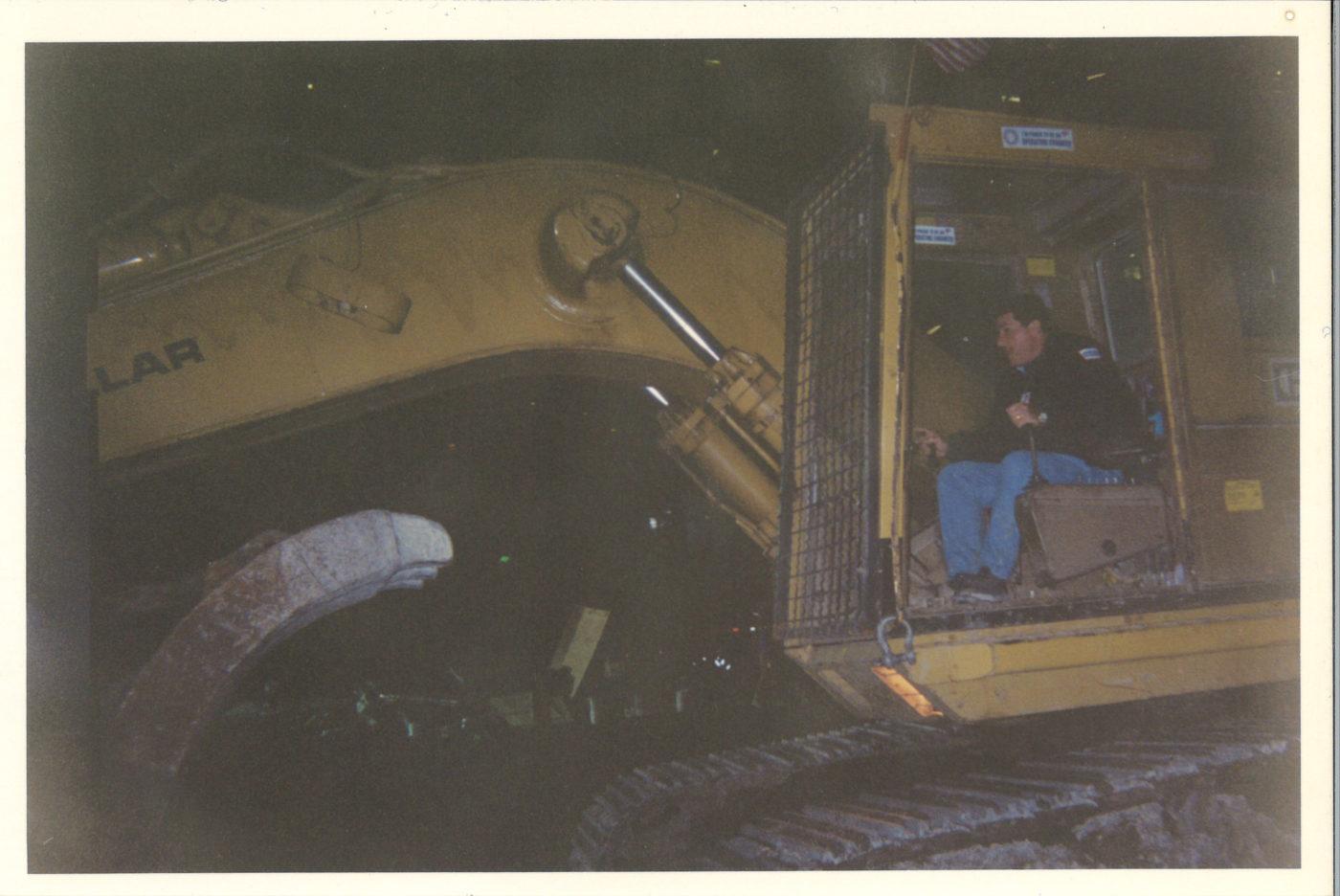 Unknown worker on heavy machiney at Ground Zero