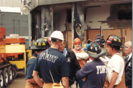 Unkown Firefighters Talking in a Circle at Ground Zero with Governor George Pataki