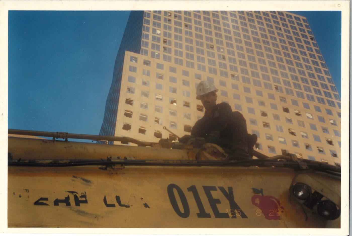 Worker on Crane Arm