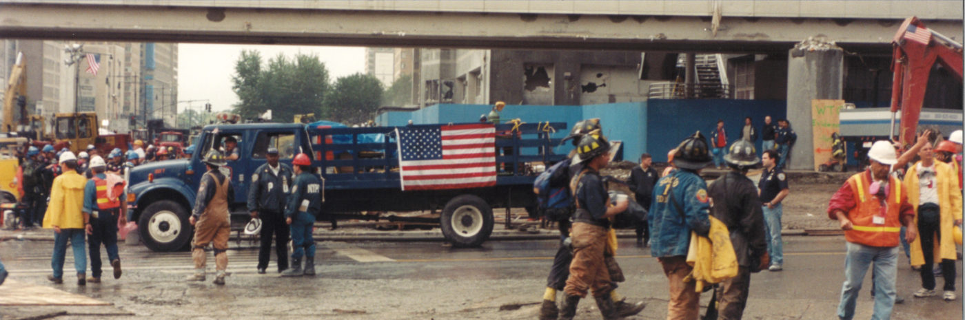 Workers and Fire Fighters Busy by a Passanger Overpass