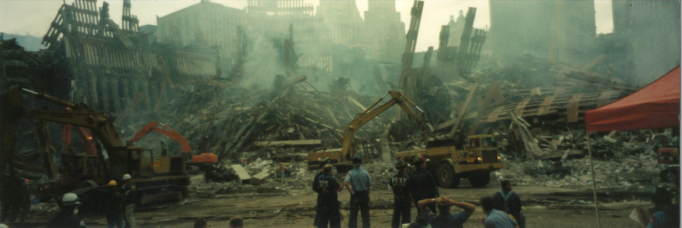 Workers and Fire Fighters Looking at Work in the Evening at Ground Zero