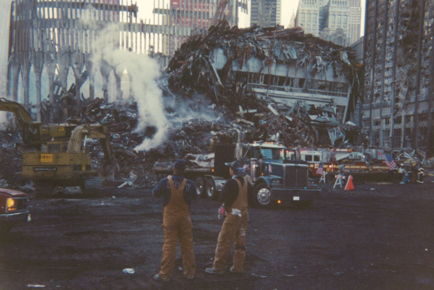 Workers at Ground Zero looking east with Ladder 87 in background