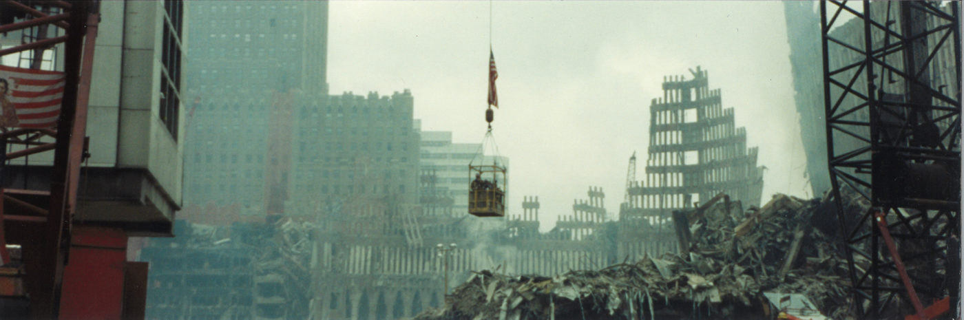 Workers in a Crane Basket infront of 140 West St and Falling Exoskeleton