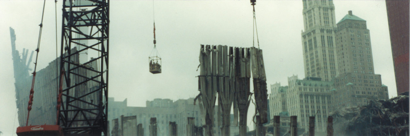 Workers in a Crane Box Close to Exoskeleton With Pieces Being Lifted Off