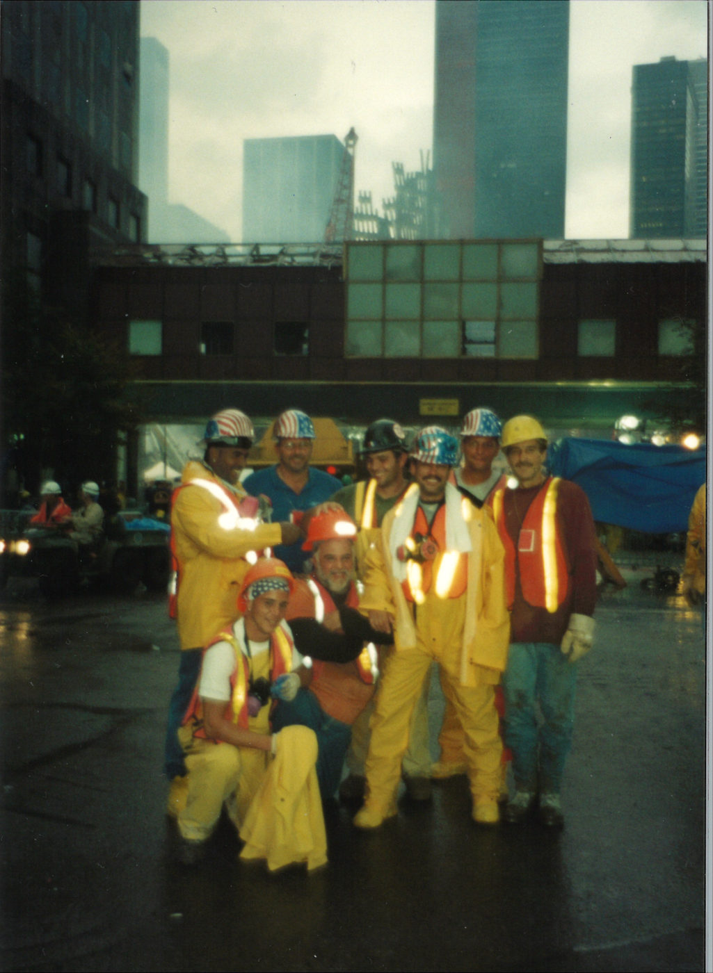 Workers in front of 200 Vesey Street with Ground Zero in background